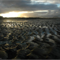 Sunset over a low tide on Musselburgh beach.